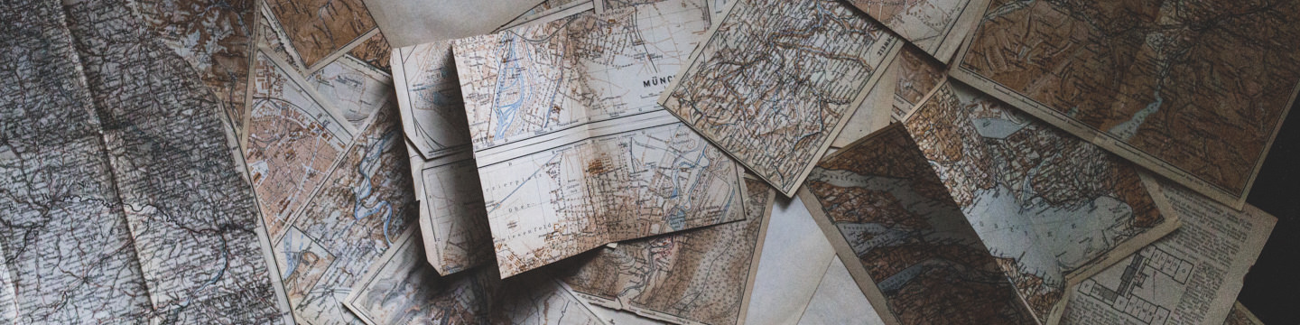 Maps, scattered across a table