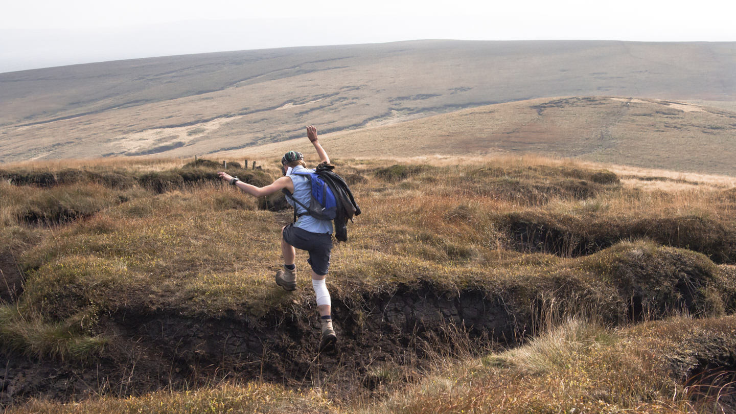 Hollie jumps eroded bogland