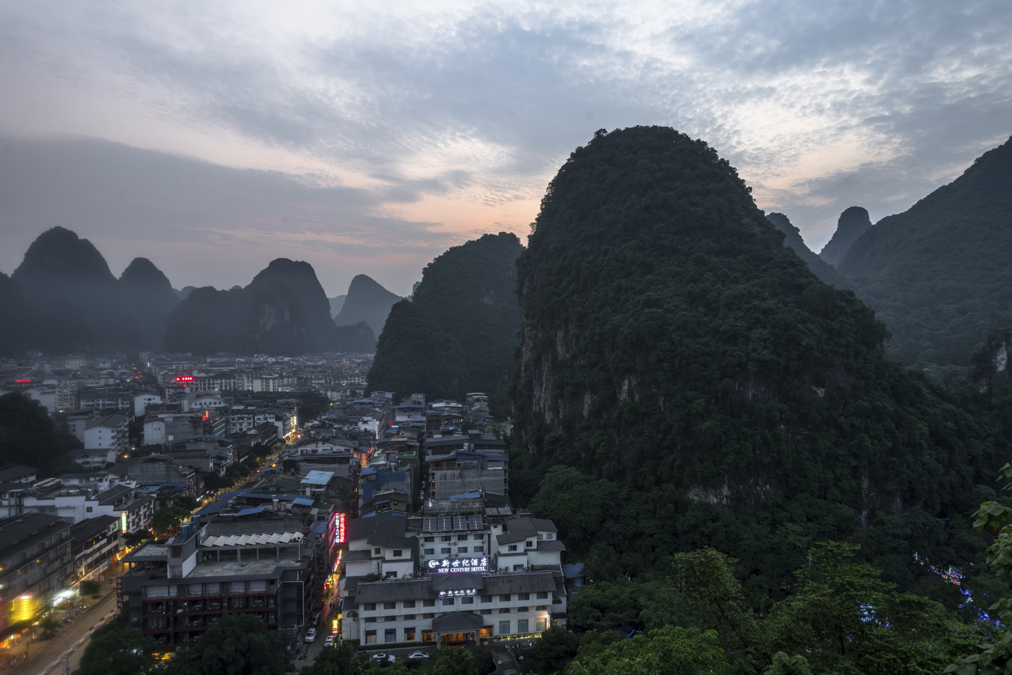 The sleepy town of Yangshuo wakes at dawn, blue and pink in the twilight.
