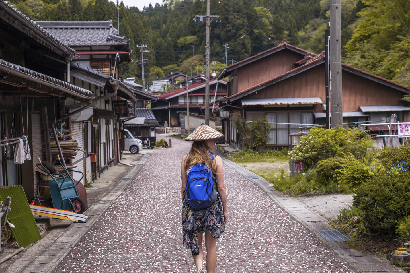 Hollie, donning conical hat walks the paved path of the Nakasendo Way