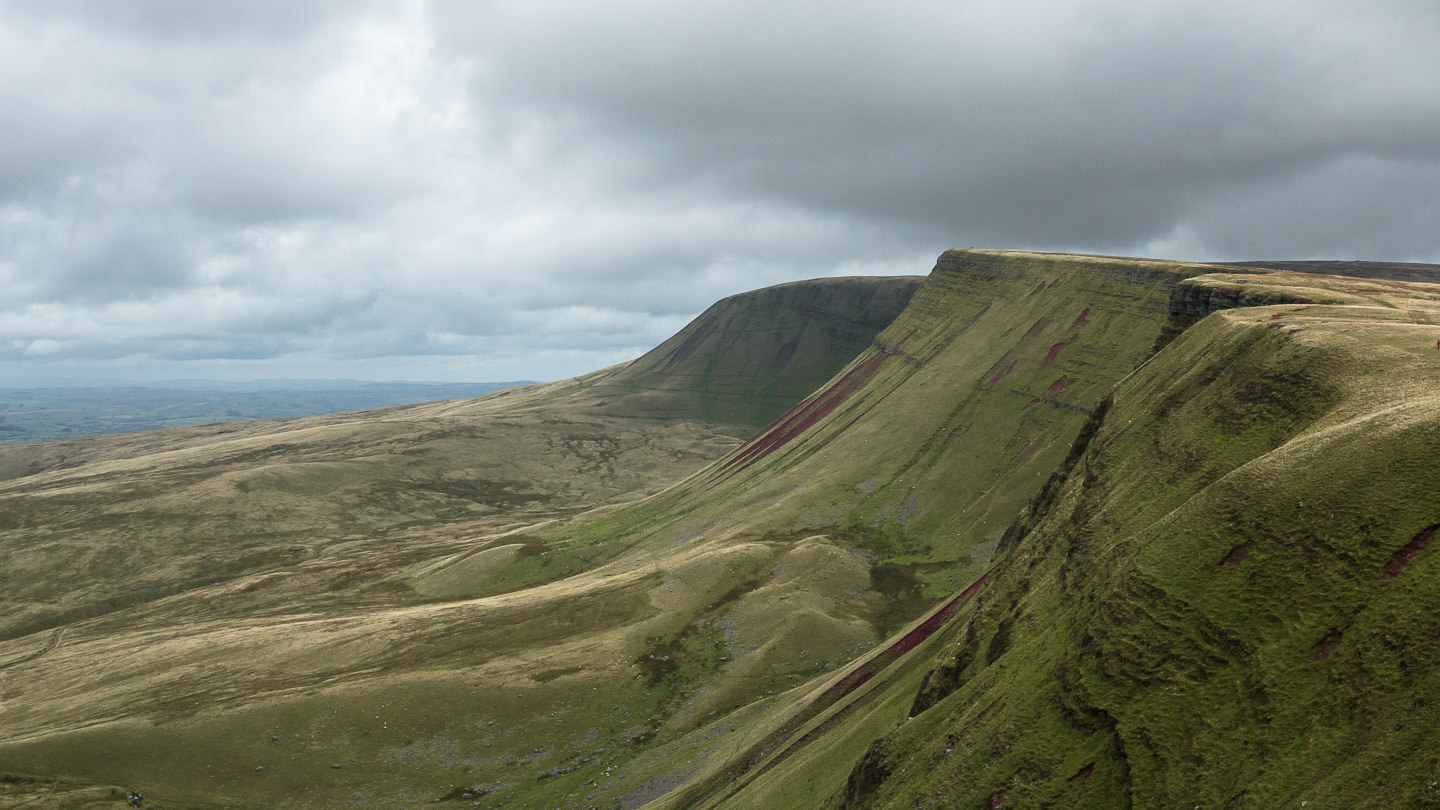 Waun Lefrith, Bannau Sir Gaer and Fan Foel line up in striking formation, their windswept forms facing outwards